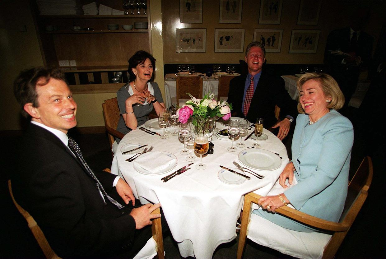 Embargoed to 0001 Tuesday July 20 File photo dated 29/05/1997 of Bill Clinton and his wife Hillary with Tony Blair (left) and his wife Cherie (2nd left) having dinner at Le Pont de la Tour Restaurant in London. Issue date: Tuesday July 20, 2021.