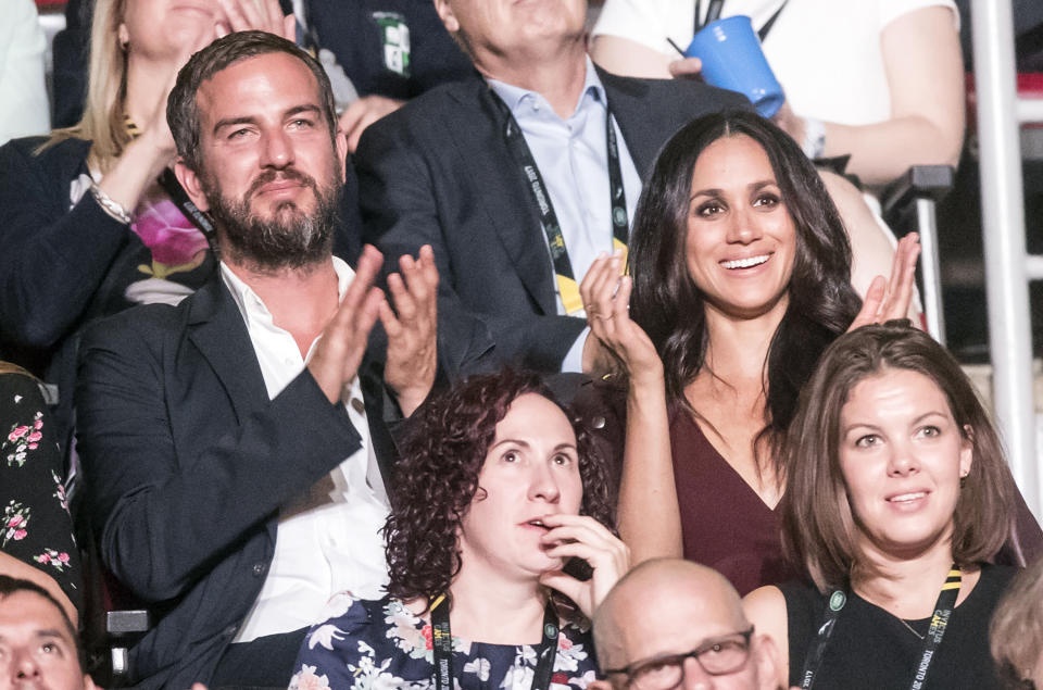 <p>Packing on the PDAs at the Invictus games in September wasn't the only royal rule the couple flouted. The fact that Meghan showed up at all actually broke with tradition. Typically, a working royal flies solo at official public events until, at the very least, an engagement is confirmed by the palace. While past royal girlfriends have attended the occasional event on the sidelines, this was something quite different.<br><em>[Photo: PA]</em> </p>