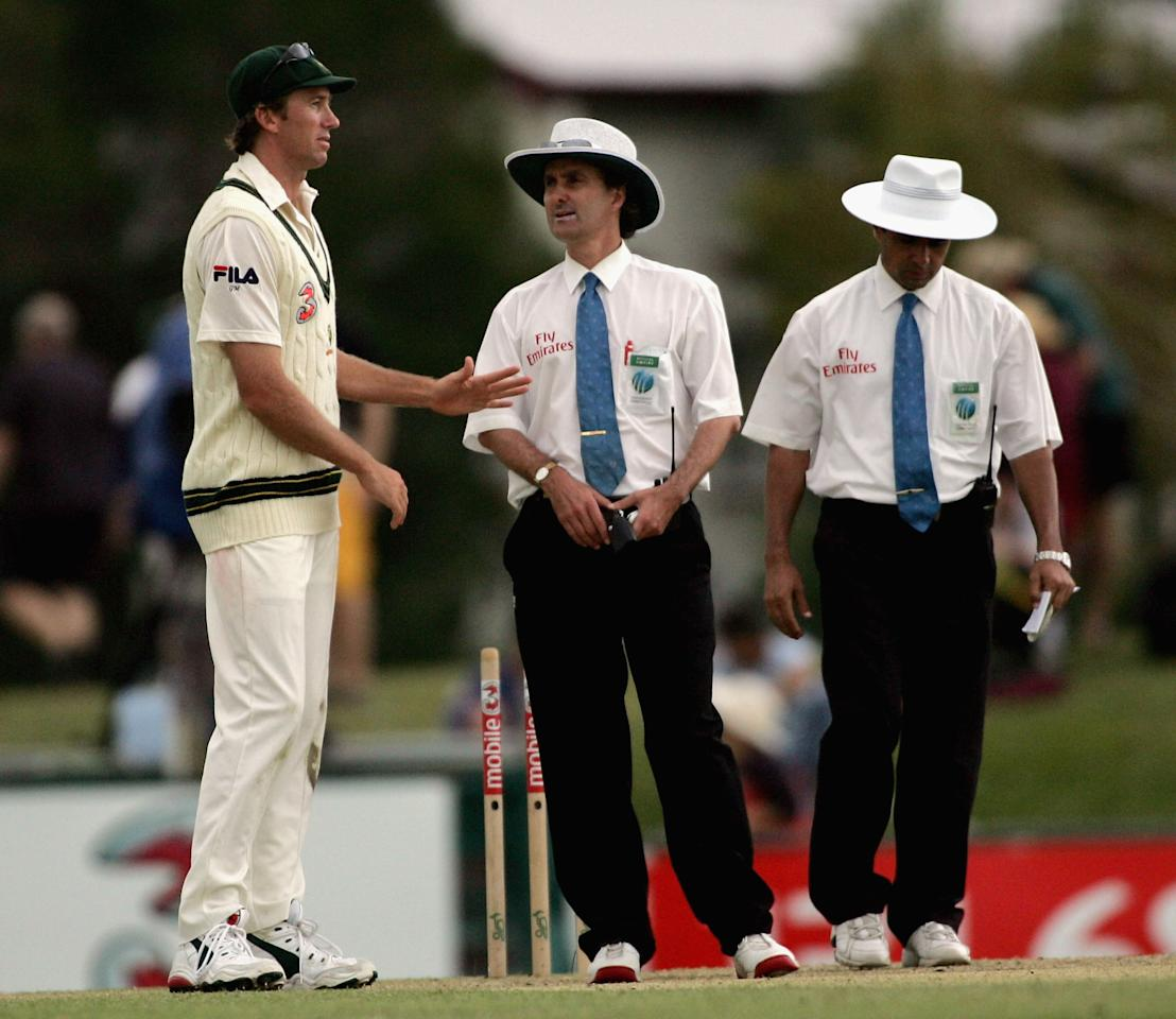 CAIRNS, AUSTRALIA - JULY 11: Glenn McGrath of Australia speaks to the umpires as bad light ends the day, during day three of the Second Test between Australia and Sri Lanka at Bundaberg Rum Stadium on July 11 2004 in Cairns, Australia. (Photo by Hamish Blair/Getty Images)