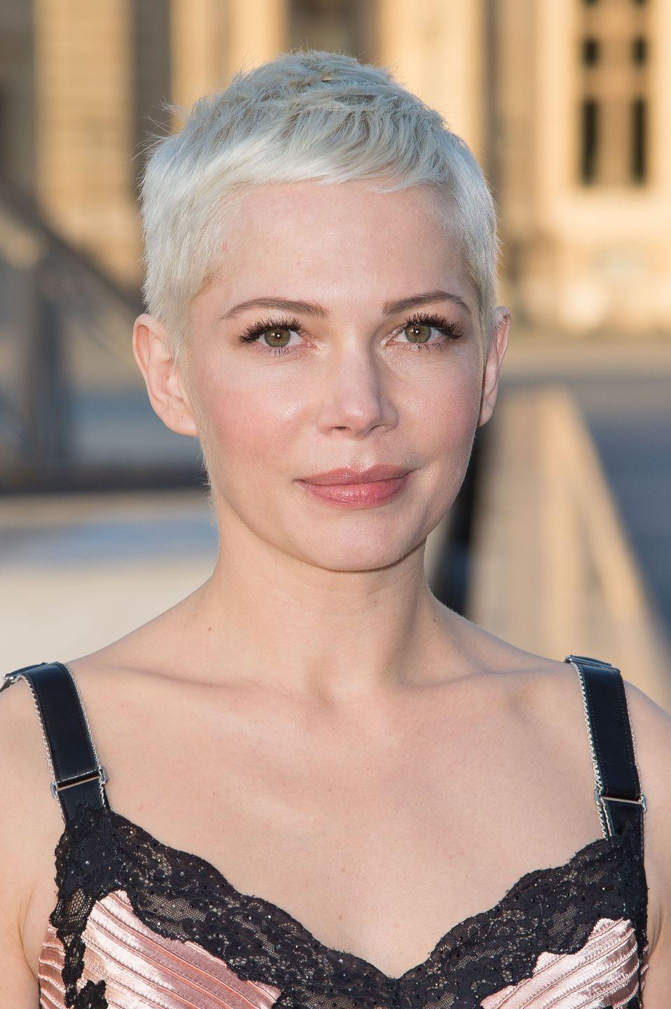 <p>Michelle Williams took her signature pixie cut shorter and blonder, with wispy bangs brushed along her forehead. </p>