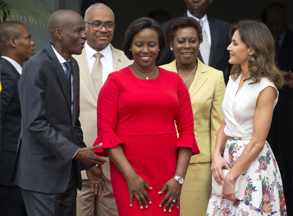 FILE - In this May 23, 2018, file photo, Haiti's President Jovenel Moise, left, and First Lady Martine Moise, in red, receive Spain's Queen Letizia Ortiz at the national Palace in Port-au-Prince, Haiti, Wednesday, May 23, 2018. Moïse was assassinated after a group of unidentified people attacked his private residence, the country's interim prime minister said in a statement Wednesday, July 7, 2021. Moïse's wife, First Lady Martine Moïse, is hospitalized, interim Premier Claude Joseph said. (AP Photo/Dieu Nalio Chery, File)