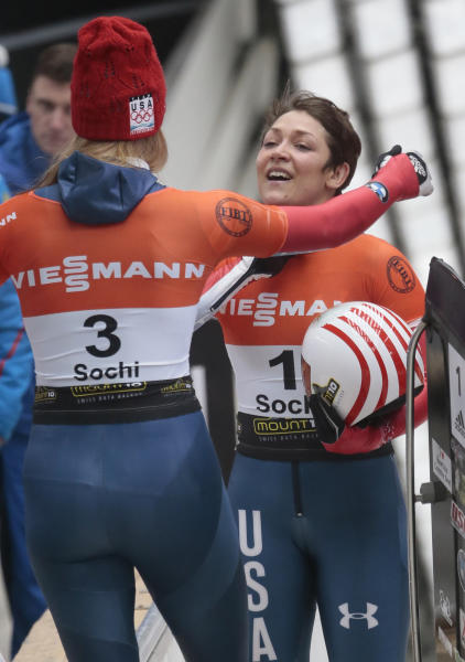 Winner Noelle Pikus-Pace, left, congratulates the second placed Katie Uhlaender, both of the U.S.A. after the finish in the women's Skeleton event at the FIBT Bob & Skeleton World Cup 2013, in Krasnaya Polyana resort, east of Sochi, Russia, Saturday, Feb. 16, 2013. (AP Photo/Mikhail Metzel)