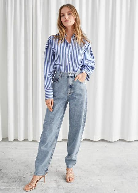 """<p><a href=""""https://www.popsugar.com/buy/amp-Other-Stories-Cropped-Mid-Rise-Jeans-558156?p_name=%26amp%3B%20Other%20Stories%20Cropped%20Mid%20Rise%20Jeans&retailer=stories.com&pid=558156&price=79&evar1=fab%3Aus&evar9=47322257&evar98=https%3A%2F%2Fwww.popsugar.com%2Fphoto-gallery%2F47322257%2Fimage%2F47322365%2FOther-Stories-Cropped-Mid-Rise-Jeans&list1=shopping%2Cdenim&prop13=api&pdata=1"""" rel=""""nofollow"""" data-shoppable-link=""""1"""" target=""""_blank"""" class=""""ga-track"""" data-ga-category=""""Related"""" data-ga-label=""""https://www.stories.com/en_usd/clothing/jeans/product.cropped-mid-rise-jeans-blue.0822894001.html"""" data-ga-action=""""In-Line Links"""">&amp; Other Stories Cropped Mid Rise Jeans</a> ($79)</p>"""