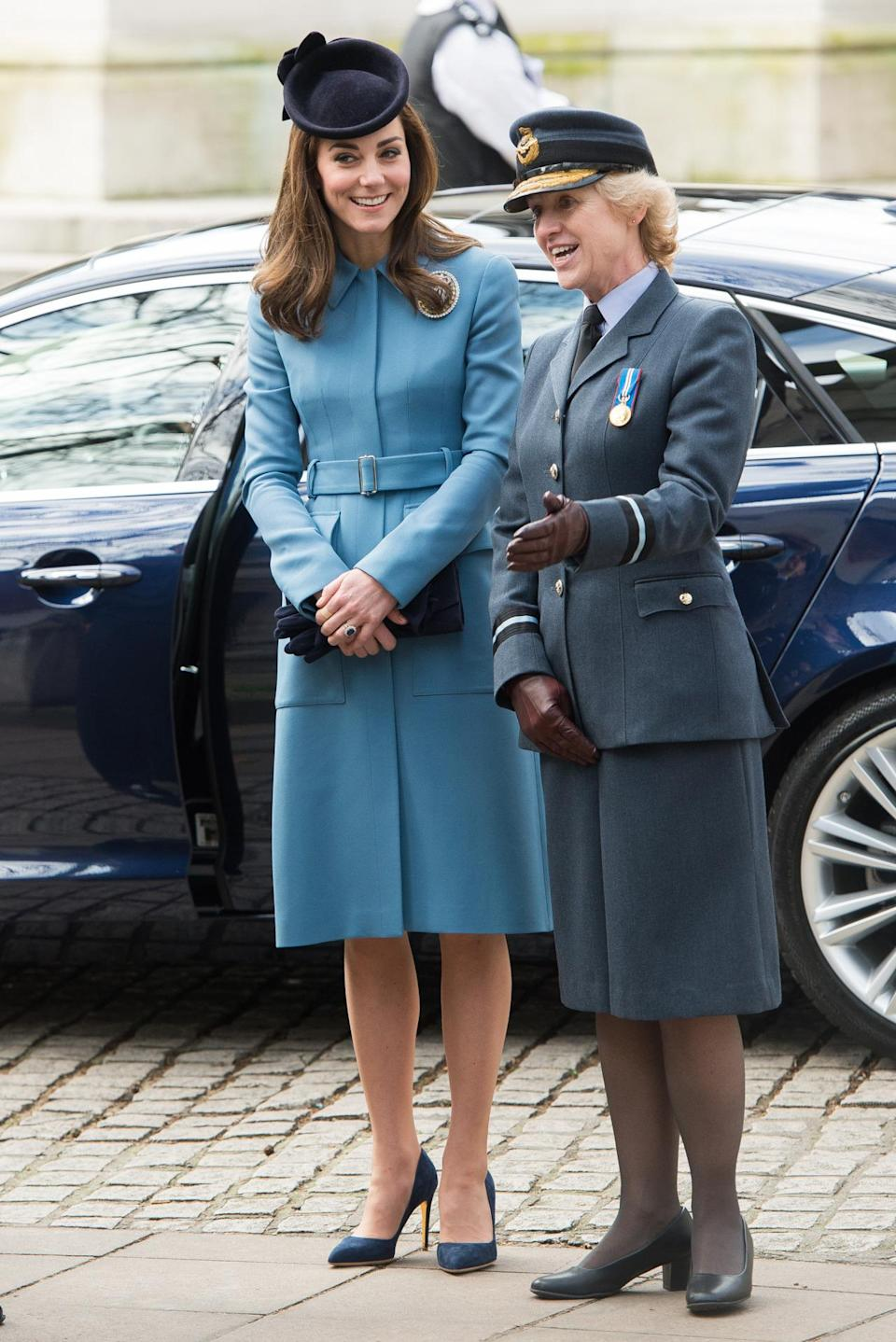 <p>Kate chose another bespoke Alexander McQueen outfit for an RAF Air Cadets event in the form of a blue belted coat. She carried a Stuart Weitzman clutch and accessorised with Rupert Sanderson suede heels and a Lock & Co hat. </p><p><i>[Photo: PA]</i></p>