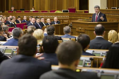 Ukraine's President Petro Poroshenko (R, top) delivers a speech during a session of the parliament in Kiev, November 27, 2014. Petro Poroshenko said on Thursday 100 percent of Ukrainians were in favour of a having single state, without federalisation, in a keynote address to the first session of a new parliament. REUTERS/Mikhail Palinchak/Ukrainian Presidential Press Service/Handout via Reuters