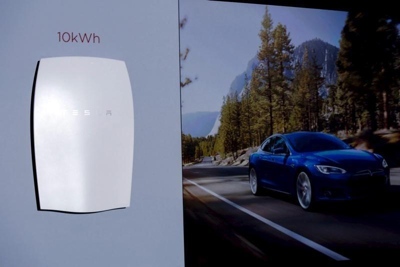 Tesla Motors CEO Elon Musk reveals the Tesla Energy Powerwall Home Battery during an event in