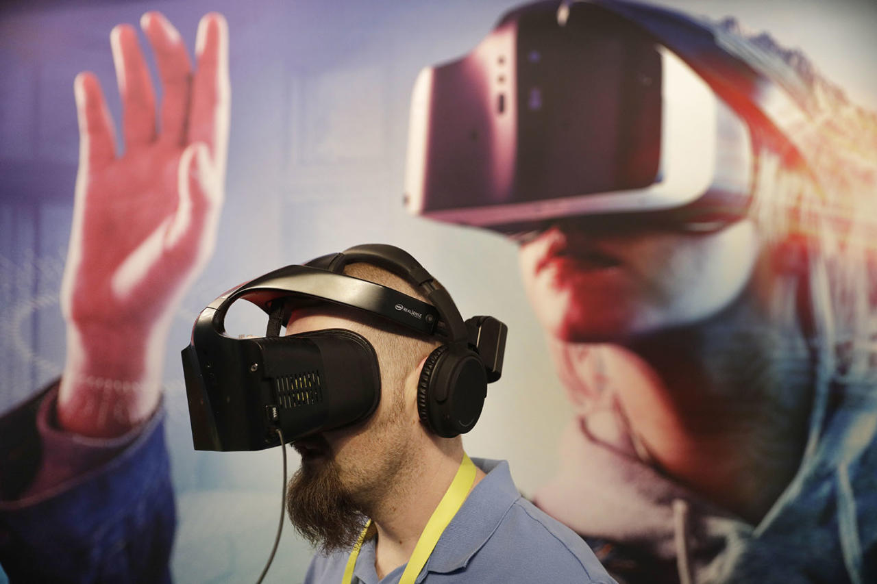<p>Brian St. George wears a Project Alloy VR headset at the Intel booth during CES International, Jan. 6, 2017, in Las Vegas. (Photo: John Locher/AP) </p>