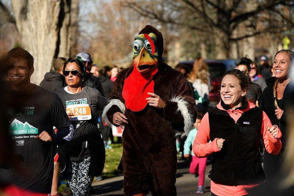 """<p>To start Thanksgiving on the right foot—and make more space for seconds or thirds—take part in a turkey trot. In light of the coronavirus pandemic and to maintain safe social distance, many local and national (like <a href=""""https://www.nyrr.org/"""" rel=""""nofollow noopener"""" target=""""_blank"""" data-ylk=""""slk:New York Road Runners"""" class=""""link rapid-noclick-resp"""">New York Road Runners</a>) races will be held virtually, meaning you can run wherever you want to, within a given time frame, and then self-report your results. Want to go the extra mile? We recommend still dressing up in silly, themed costumes—just as you would IRL.</p>"""