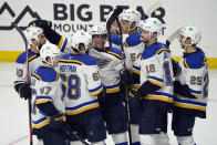 St. Louis Blues' Mike Hoffman (68) celebrates his winning goal with teammates during overtime of an NHL hockey game against the Los Angeles Kings, Friday, March 5, 2021, in Los Angeles. (AP Photo/Marcio Jose Sanchez)