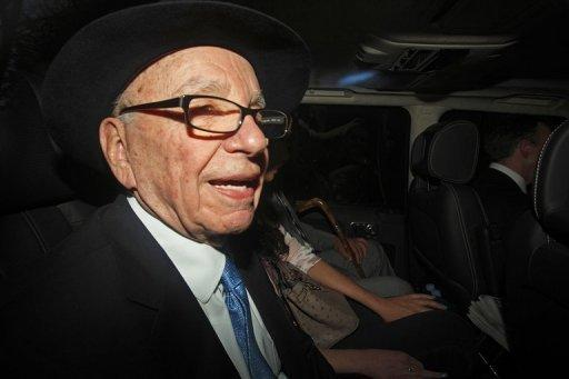 Rupert Murdoch, pictured in April, has stepped down as director of a number of companies behind British newspapers The Sun, The Times and The Sunday Times, a News International spokeswoman said on Saturday