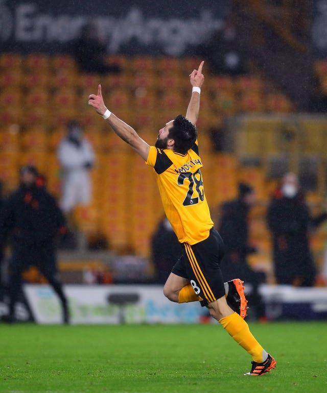 Joao Moutinho celebrates his brilliant winner