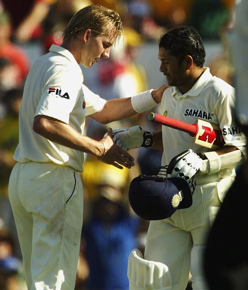 SYDNEY, AUSTRALIA - JANUARY 3:  Brett Lee of Australia congratulates Sachin Tendulkar of India on his double century during day two of the 4th Test between Australia and India at the SCG on January 3, 2004 in Sydney, Australia. (Photo by Hamish Blair/Getty Images)