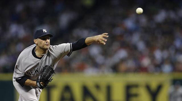 New York Yankees starting pitcher Andy Pettitte throws during the second inning of a baseball game against the Houston Astros Saturday, Sept. 28, 2013, in Houston. (AP Photo/David J. Phillip)