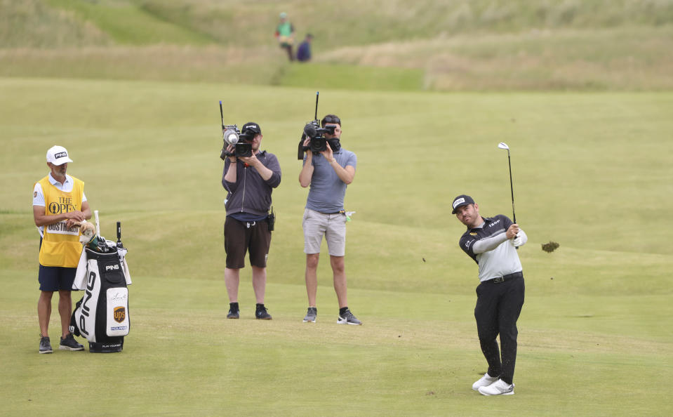 South Africa's Louis Oosthuizen play his shot to the 18th green during the first round British Open Golf Championship at Royal St George's golf course Sandwich, England, Thursday, July 15, 2021. (AP Photo/Ian Walton)