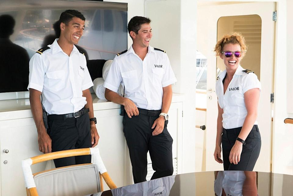 Bruno Duarte, Nico Sholly, and Baker Manning on a yacht deck in uniform