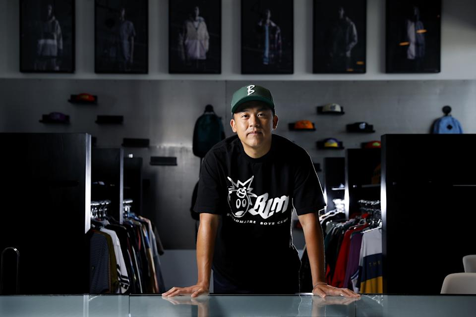 """The Hundreds cofounder Bobby Kim at the company's office in Vernon. <span class=""""copyright"""">(Christina House / Los Angeles Times)</span>"""