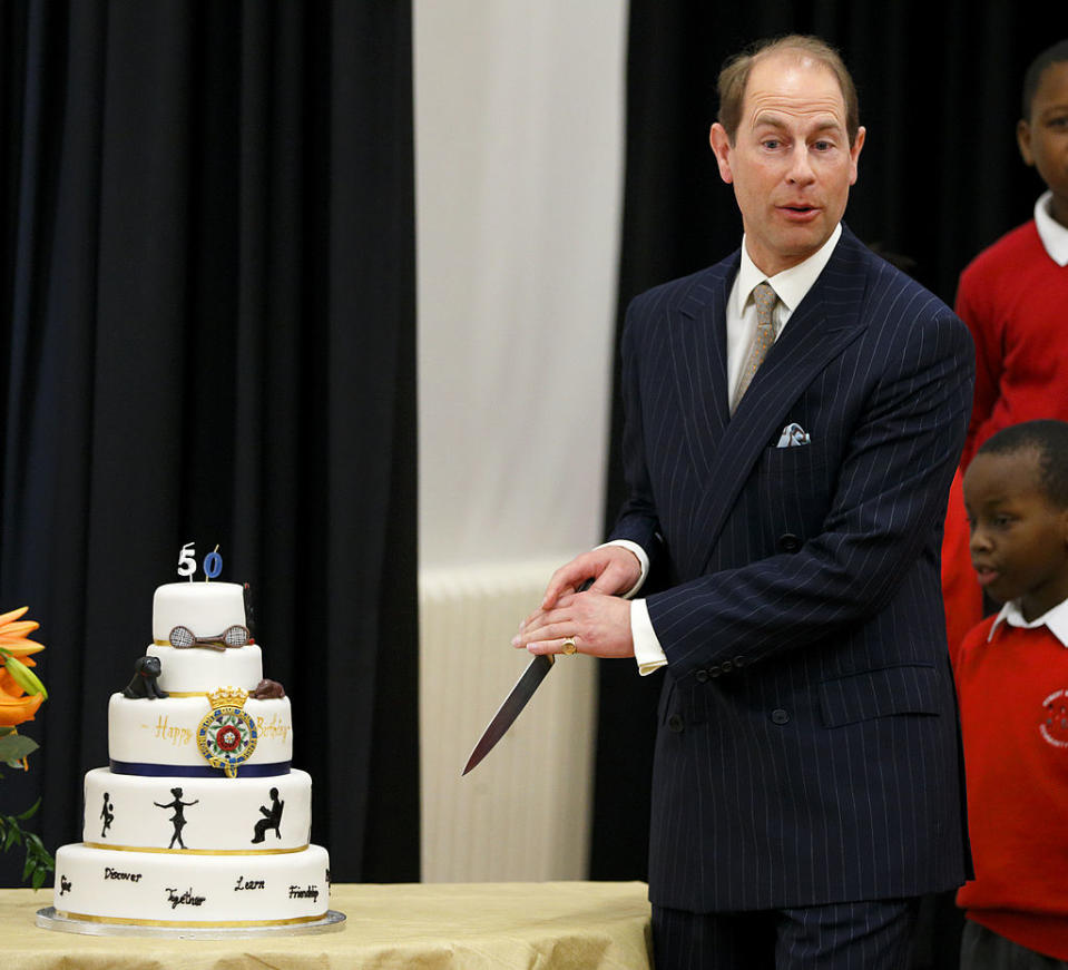 Prince Edward, pictured here cutting a cake in 2014, has been mocked for his technique. [Photo: Getty]