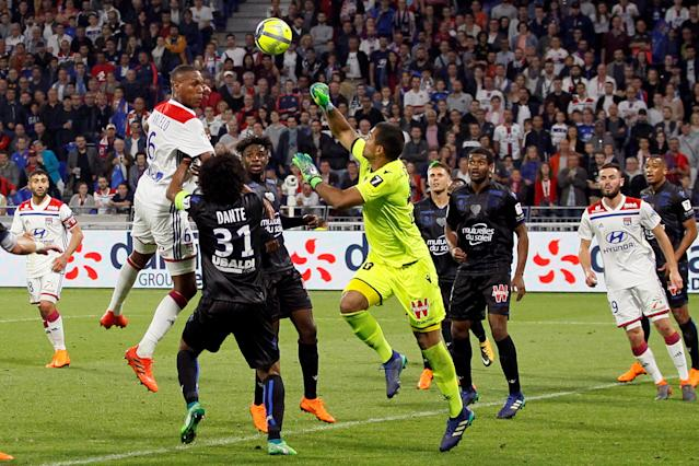 Soccer Football - Ligue 1 - Olympique Lyonnais vs OGC Nice - Groupama Stadium, Lyon, France - May 19, 2018 Lyon's Marcelo in action with Nice's Walter Benitez REUTERS/Emmanuel Foudrot