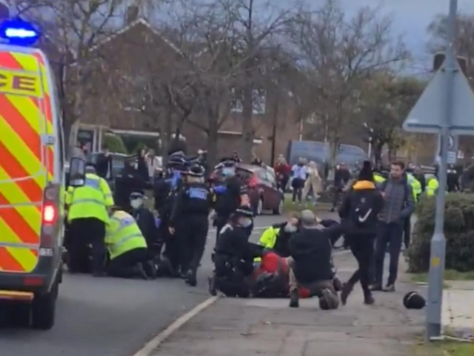 <p>Video footage shows a number of protesters in handcuffs before being lead away by officers</p>@outsider63
