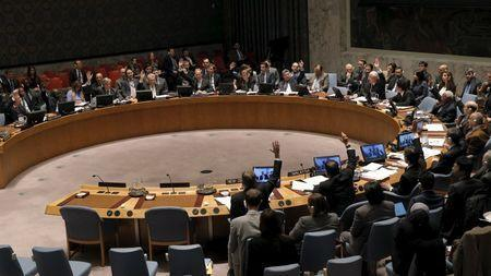 The United Nations Security Council votes to approve a resolution endorsing the planned halt in fighting in Syria at the United Nations Headquarters in New York February 26, 2016. REUTERS/Brendan McDermid