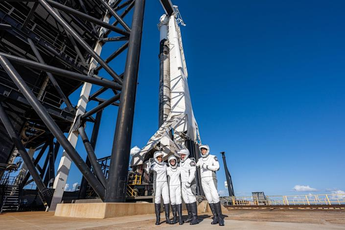 The Inspiration4 crew poses at the base of the Falcon 9 rocket before strapping in for launch. Left to right: Sian Proctor, Hayley Arceneaux, Chris Sembroski and mission commander Jared Isaacman, the billionaire who paid for the first privately funded trip to orbit. / Credit: SpaceX