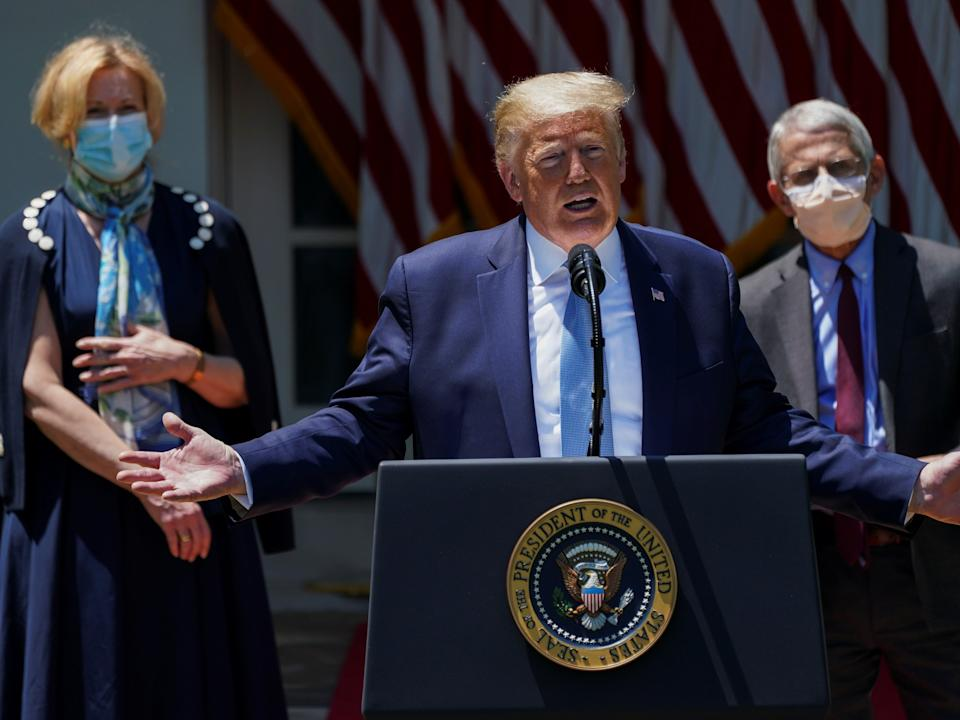 At a May press conference in the Rose Garden at the White House, President Donald Trump opted against wearing a face mask while advisers Drs. Anthony Fauci and Debroah Birx wore them.