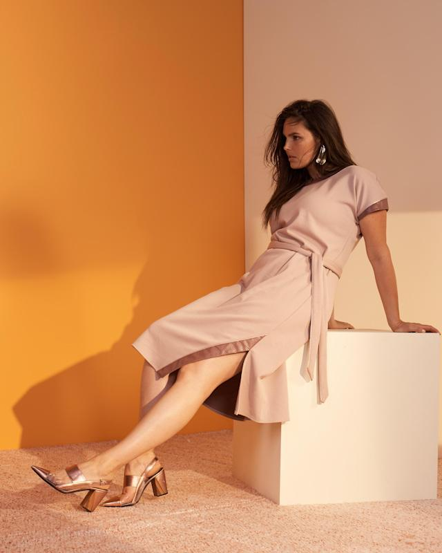 Candice Huffine wears a pink pastel dress from the new Prabal Gurung x Lane Bryant collection. (Photo: Courtesy of Lane Bryant)