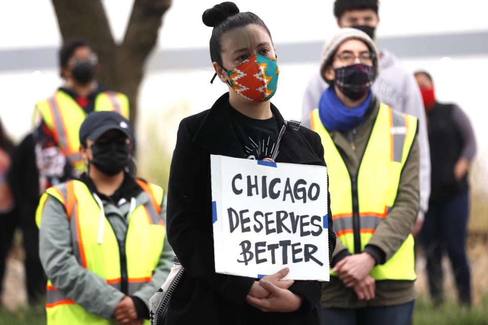"Chicago's Little Village neighborhood resident Maria Cecilia Quinones displays a sign reading ""Chicago Deserves Better"" during a rally on Sunday, April 11, 2021 organized by the Little Village Environmental Justice Organization honoring the community members who have lost their lives to environmental racism, in particular to last year's botched smokestack implosion in the Little Village area. (AP Photo/Shafkat Anowar)"