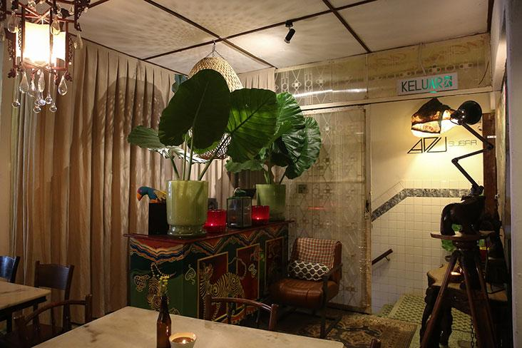 Furniture in the restaurant were foraged from vintage shops and some, like the service counter is hand painted by Adu himself