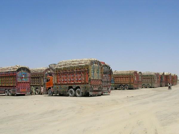 Trucks loaded with supplies that are to cross into Afghanistan at a crossing point in the Pakistan-Afghanistan border town of Chaman.