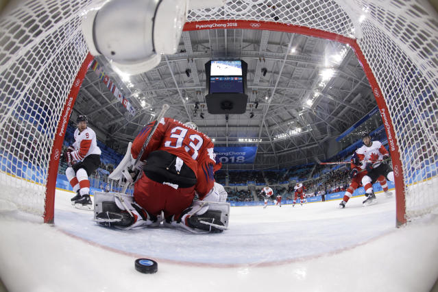 Derek Roy (9), of Canada, shoots the puck past goalie Pavel Francouz (33), of the Czech Republic, for a goal during the first period of the men's bronze medal hockey game at the 2018 Winter Olympics in Gangneung, South Korea, Saturday, Feb. 24, 2018. (AP Photo/Matt Slocum, Pool)