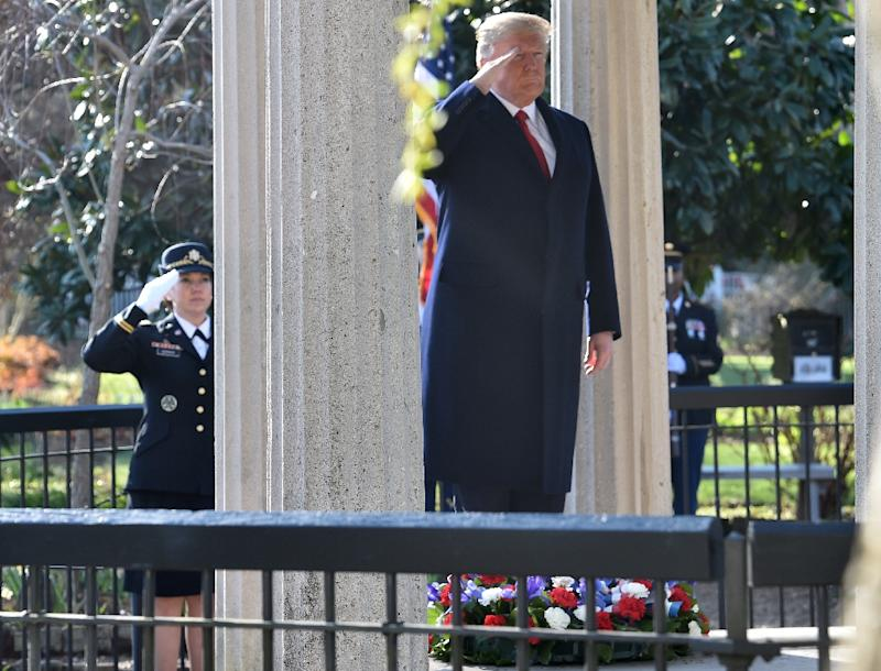 US President Donald Trump salutes after laying a wreath at the tomb of former president Andrew Jackson in Nashville, Tennessee on March 15, 2017