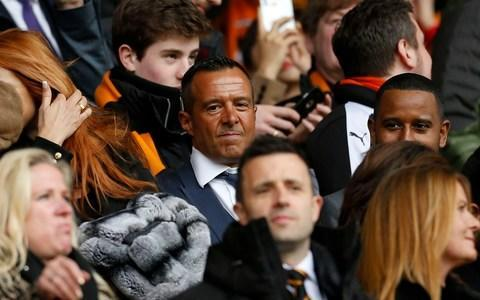 "Nuno Espirito Santo has just stepped off the open-top bus and is battling to put the brakes on rising expectations in the Black Country. It is a few hours after the promotion party in Wolverhampton's city centre, where over 80,000 fans came to celebrate the club clinching a return to the Premier League for the first time since 2012. The Nuno revolution has delivered a glorious season of entertainment, with Wolves playing a brand of stylish football that has seen them described as the Manchester City of the Championship. They have already been installed as joint-seventh favourites for the title next season and Nuno is shifting a little uncomfortably in his seat as he reflects on what happens next. ""What I feel is that expectations are very high and I am the only one that my expectations aren't so high. I am very cautious of what's going on. The summer is important, to have decisions on the squad and then we will see,"" he said. ""We have to improve and work hard but we cannot say we are going to fight for the top 10 or fight forever. That will be a big mistake. Nuno Espirito Santo celebrates with the Championship trophy Credit: ACTION IMAGES ""We are one year ahead of schedule. I am not obsessed about making an impression on the Premier League. I want to build a team who can play home and away the same. ""It is not my job to restrain their expectations, but just be realistic. If we can achieve what we want sooner, we will go for it."" Nuno will be backed with significant funds by Wolves' ambitious owners, Fosun, and the ultimate aim is to bring Champions League football to Molineux. It may sound all too familiar, and perhaps even a cautionary tale, but Nuno's impact in the Black Country has been so remarkable that it seems anything is possible. To navigate a route out of the Championship, in his first season in English football, is an achievement that cannot be underestimated. ""It is the toughest league in the world,"" he said. ""There were a lot of games, but when we played Sheffield Wednesday away [and won 1-0 in December] I said 'something is happening'. ""The big achievement that the boys were able to achieve was that when we had a bad result or a bad performance, the next game we were able to give a better answer. ""We bounced back almost 100 per cent of the time. One time we drew after a defeat but the reaction of the team was different. One of the things that is most difficult for a manager is reversing bad results and keeping going. Now the one game I want to see is the Championship play-off, I would like that more than the Champions League Final."" This is Nuno at his most relaxed and open, even stopping mid-sentence to pull out his mobile phone and show a video of him hitting an exploding golf ball, after falling victim to a prank from one of his players. 80,000 fans watch the parade Credit: GETTY IMAGES He is absorbing company, talking about the ""identity and the idea"" of his teams and how he can often be lonely without his family, who still live in Portugal. He is also obsessed with the small details, such as rearranging the tables in the training ground canteen to encourage team spirit. The only time his mood darkens a little is when the name Jorge Mendes is brought up. Mendes, the super-agent with close links to Fosun and Nuno, has delivered a number of players to Wolves and generated much ill-feeling among their Championship rivals. ""I cannot control that and it doesn't take my mind,"" he said, waving away his hand dismissively. ""I don't waste time thinking about it. I don't care, I really don't care. Honest. ""Jorge doesn't have any job here. Any job at all. You see him here? Come on. He is a good agent, the best agent. We get what we need from him. If he can provide good players for us? Fantastic. If another guy can give? Fantastic. It is not the job of Jorge doing here."" Super-agent Jorge Mendes has helped Wolves recruit players Credit: GETTY IMAGES Nuno is happier talking about his plans for the future, with a meeting scheduled later this month over Wolves' strategy for the summer. He will return to Portugal later this week to ""lie on the sofa and watch the World Cup"" before hopping aboard the rollercoaster again in late June for pre-season training. The joyous scenes on Bank Holiday Monday will certainly be etched in his mind this summer. ""It was crazy and is fantastic for us. I have a lot of titles but as a coach it is my first title. When you win you want to repeat it. ""We have to take advantage of what happened today - 30,000 people, just to see the faces of the people who were here saying thank you, to the players it means a lot and for me and for us it means a lot. ""Of course I am excited about testing myself in the Premier League. It is something really good."""