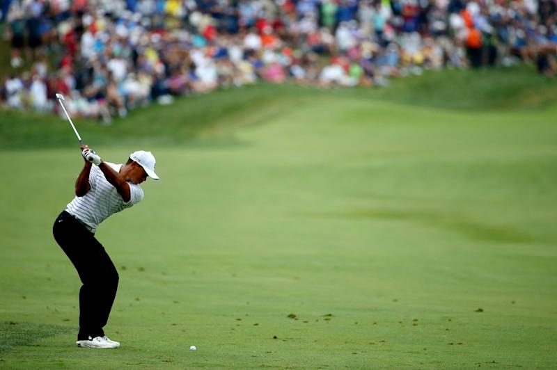 Tiger Woods hits his second shot on the 18th hole during the second round of the PGA Championship in Louisville on August 8, 2014 (AFP Photo/Andy Lyons)