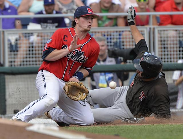 Texas Tech's Alec Humphreys, right, beats the throw to third base against Mississippi third baseman Austin Anderson (8), after Humphreys hit a triple in the sixth inning of an NCAA baseball College World Series elimination game in Omaha, Neb., Tuesday, June 17, 2014. (AP Photo/Ted Kirk)