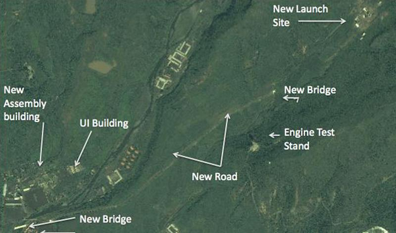 In this satellite image taken Aug. 29, 2012 by DigitalGlobe and provided Monday, Sept. 24, 2012 by 38 North, the website of the U.S.-Korea Institute at Johns Hopkins School of Advanced International Studies, a structure which an analyst says a unfinished rocket launch site, top right, and other major new facilities at the Tonghae launch complex are seen near the village of Musudan-ri on the northeast coast of North Korea. North Korea has stopped construction on a launch pad where intercontinental-range rockets could be tested, an interruption possibly due to heavy rains and that could stall completion up to two years, according to the analysis of Aug. 29 images provided to The Associated Press by 38 North. (AP Photo/DigitalGlobe) NO SALES, MANDATORY CREDIT