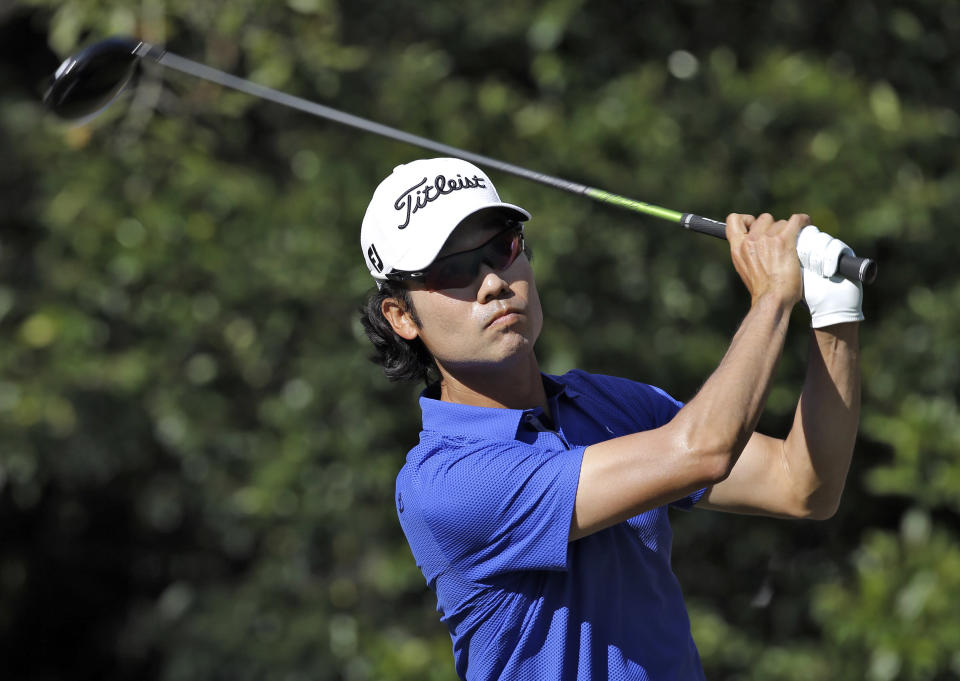Kevin Na tees off on the 11th hole during the third round of the Valspar Championship golf tournament at Innisbrook Saturday, March 15, 2014, in Palm Harbor, Fla. (AP Photo/Chris O'Meara)