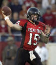 FILE - Texas Tech quarterback Sonny Cumbie passes in the first quarter in Lubbock, Texas, in this Saturday, Oct. 23, 2004, file photo. Cumbie is on pace to become the third straight Texas Tech quarterback to lead the nation in passing, a statistic that leads some to question whether he's just another product of coach Mike Leach's wide-open offense. Four former Big 12 quarterbacks are coaching QBs at their alma mater, with three new in those roles this spring. Collin Klein, the 2012 Heisman Trophy finalist at Kansas State, is going into his fifth season as the Wildcats quarterback coach. The new trio are Sonny Cumbie at Texas Tech, Kenny Hill at TCU and Shawn Bell at Baylor. (AP Photo/L.M. Otero, File)