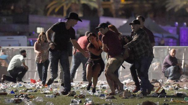 PHOTO: People carry a an injured person at the Route 91 Harvest country music festival after gun fire was heard, Oct. 1, 2017 in Las Vegas. ( David Becker/Getty Images)