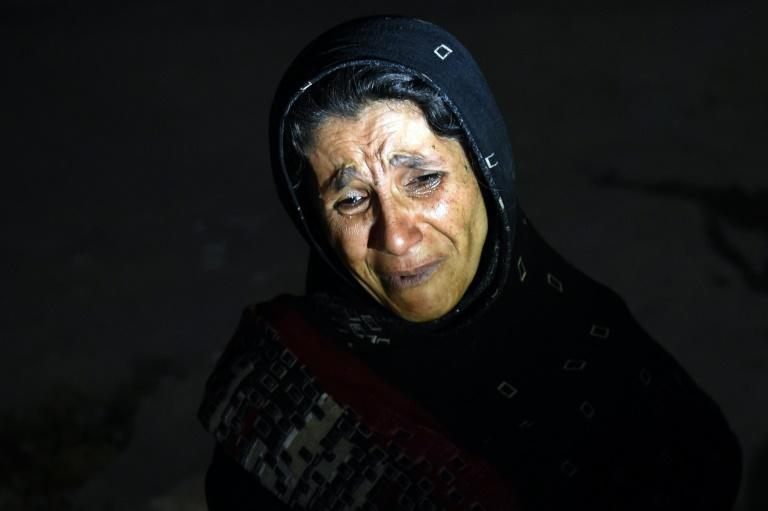 An Afghan woman cries as she looks for her son after a suicide attack at the entrance to the Police Academy in Kabul on August 7, 2015