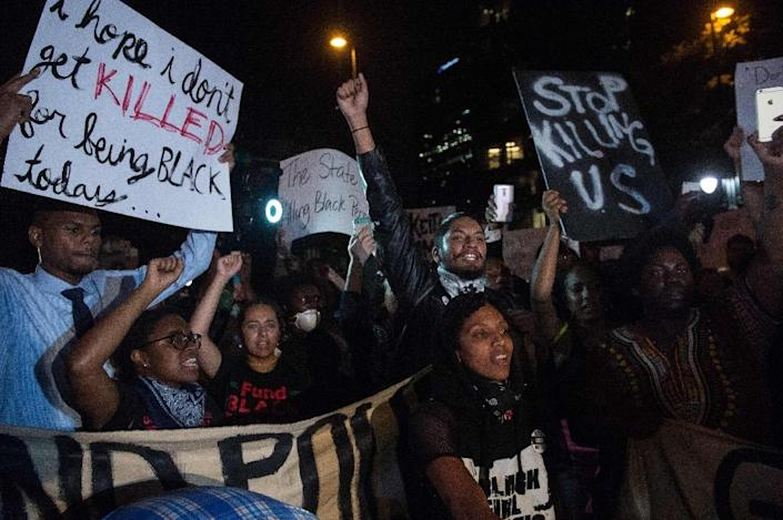 Protesters chant slogans during a march in Charlotte, North Carolina, on September 22, 2016, the third night of protests following the fatal police shooting of a black man (AFP Photo/Nicholas Kamm)