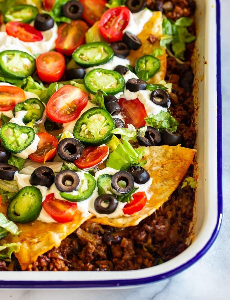 """<p>Top this beefy taco casserole with tortilla chips for a nice crunch with every bite. Go wild with your garnishes!</p><p><strong>Get the recipe at <a href=""""https://whiskitrealgud.com/low-carb-taco-casserole/"""" rel=""""nofollow noopener"""" target=""""_blank"""" data-ylk=""""slk:Whisk It Real Gud"""" class=""""link rapid-noclick-resp"""">Whisk It Real Gud</a>.</strong> </p>"""
