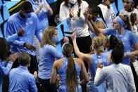 North Carolina head coach Courtney Banghart, center, talks to her team during a timeout in the first half of a college basketball game against Alabama in the first round of the women's NCAA tournament at the Alamodome in San Antonio, Monday, March 22, 2021. (AP Photo/Eric Gay)
