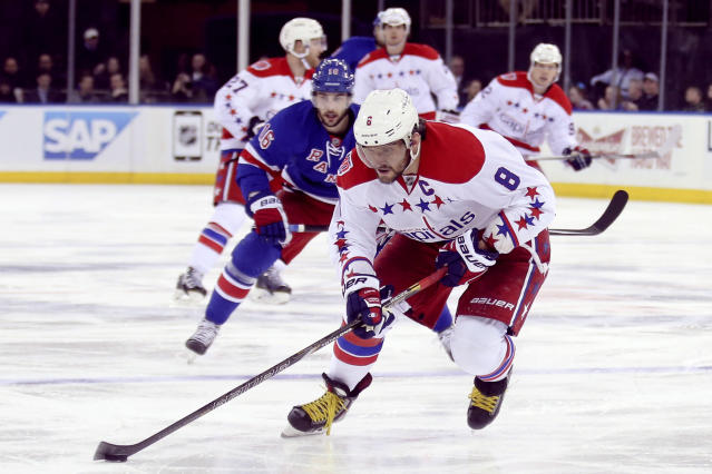 Washington Capitals left wing Alex Ovechkin (8) skates the puck up the ice during the third period of an NHL hockey game against the New York Rangers, Sunday, March 29, 2015, in New York. The Capitals won 5-2. (AP Photo/John Minchillo)