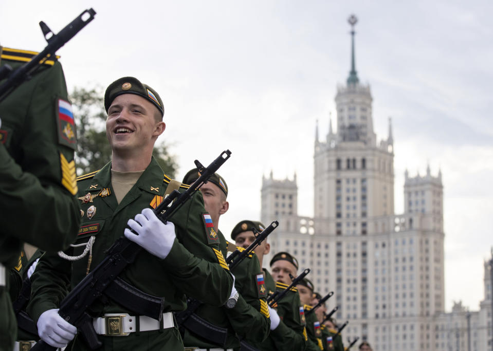 Russian soldiers march toward Red Square to attend a dress rehearsal for the Victory Day military parade in Moscow, Russia, Saturday, June 20, 2020. The military parade marking the 75th anniversary of the Nazi defeat was postponed from May 9 due to the outbreak of the coronavirus pandemic and is now set to take place on June 24. (AP Photo/Alexander Zemlianichenko)