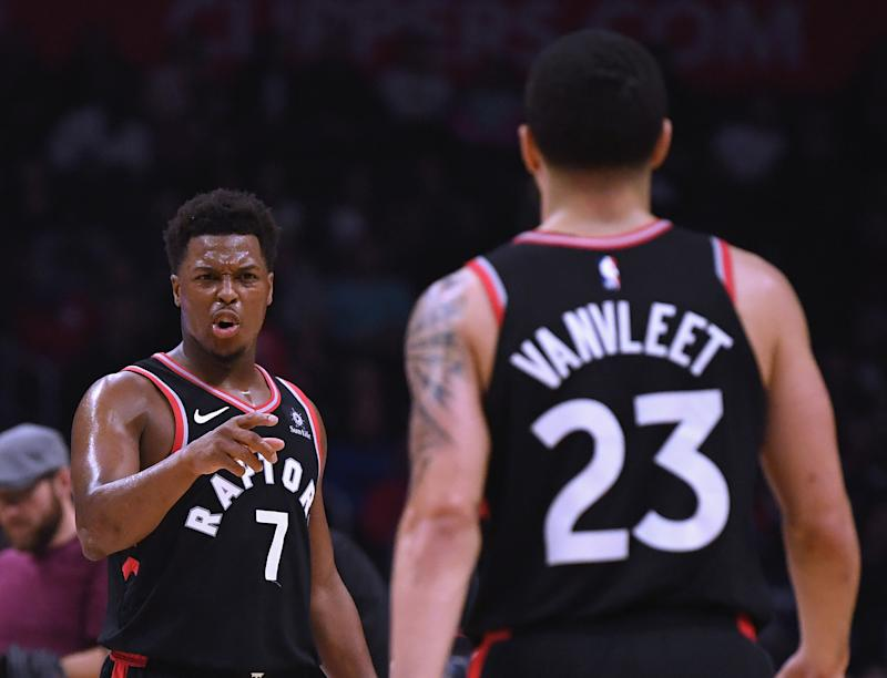 LOS ANGELES, CA - DECEMBER 11: Kyle Lowry #7 of the Toronto Raptors celebrates a 103-74 lead with Fred VanVleet #23 at the end of the third quarter at Staples Center on December 11, 2018 in Los Angeles, California. NOTE TO USER: User expressly acknowledges and agrees that, by downloading and or using this photograph, User is consenting to the terms and conditions of the Getty Images License Agreement. (Photo by Harry How/Getty Images)