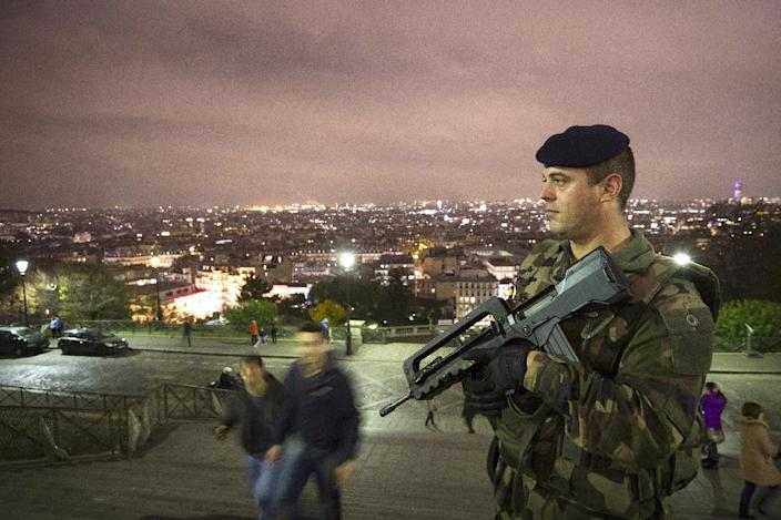 A French soldier enforcing France's national security alert system, patrols in front of the Sacre Coeur Basilica on November 16, 2015 in Paris (AFP Photo/Joel Saget)