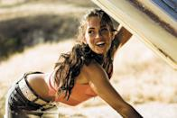 <p>Megan's <b>Transformers</b> look had that classic Abercrombie &amp; Fitch vibe with a belted denim miniskirt, turquoise beaded hoops, and coral ribbed tank that revealed a rainbow, halter-style bikini top.</p>