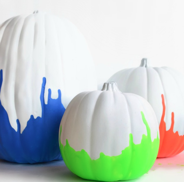 "<p>We love these brightly dipped creations that nod to '80s fashion. Begin by painting your pumpkin white and then dip it into a thick pool of neon acrylic paint. Hold it upside down until you get the drip effect you want. <i>(Photo: <a href=""http://anightowlblog.com/2013/09/neon-paint-dipped-pumpkins.html/"" rel=""nofollow noopener"" target=""_blank"" data-ylk=""slk:anightowlblog"" class=""link rapid-noclick-resp"">anightowlblog</a>)</i></p>"