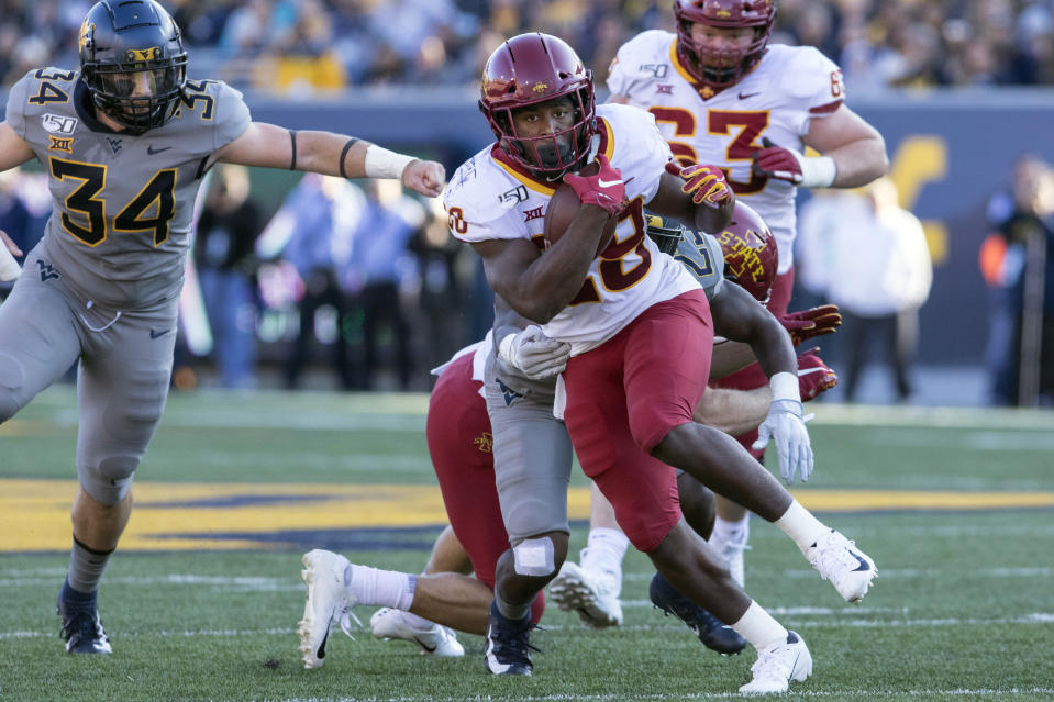 Iowa State running back Breece Hall (28) escape the tackle of West Virginia safety Tykee Smith (23) during the first half of an NCAA college football game Saturday, Oct. 12, 2019, in Morgantown, W.Va. (AP Photo/Raymond Thompson)